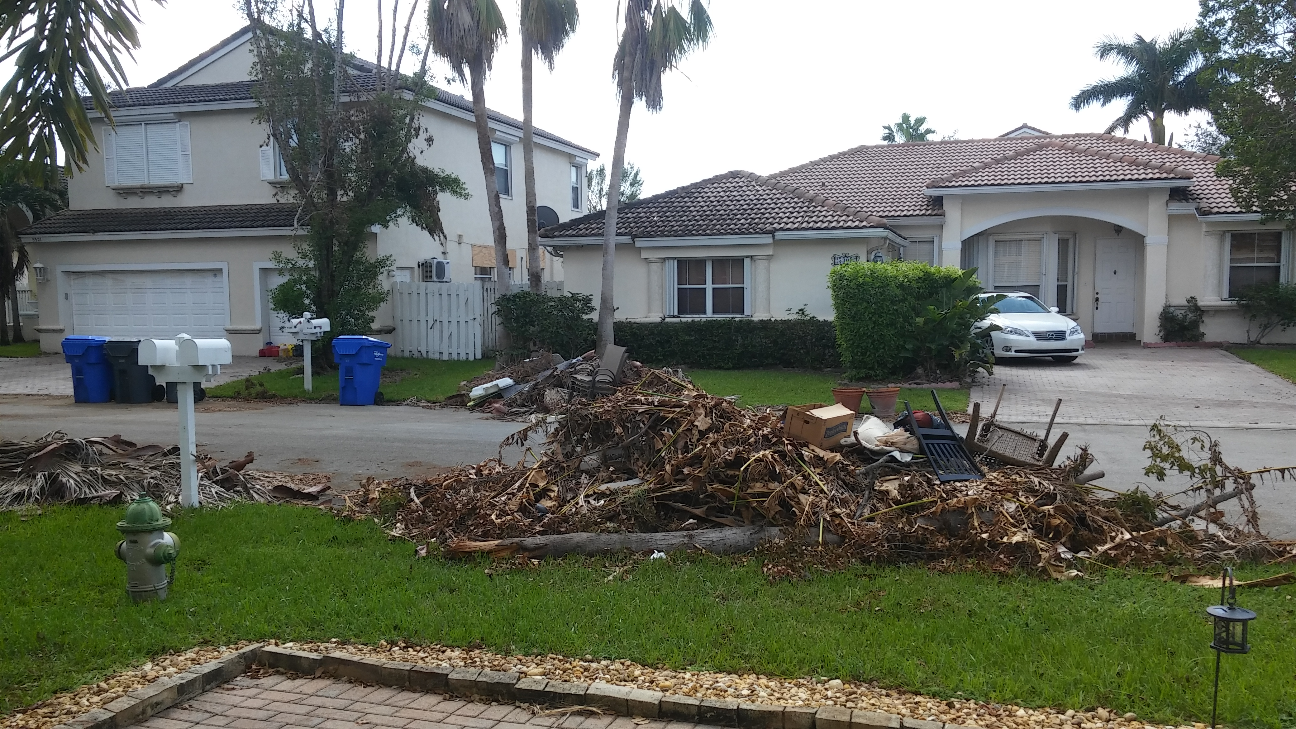 Pile of debris in front of home